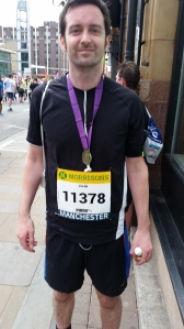Me after the Manchester 10k. My time...49.09. Well chuffed as the year before I did it in 54.00.